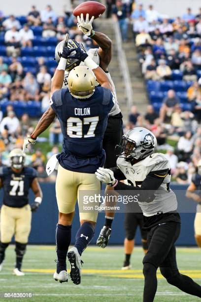Knights defensive back Mike Hughes deflects a pass intended for Navy Midshipmen wide receiver Brandon Colon on October 21 at Navy Marine Corps...