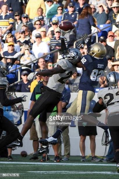 Knights defensive back Tre Neal deflects a pass intended for Navy Midshipmen wide receiver Craig Scott for an interception in the second quarter on...