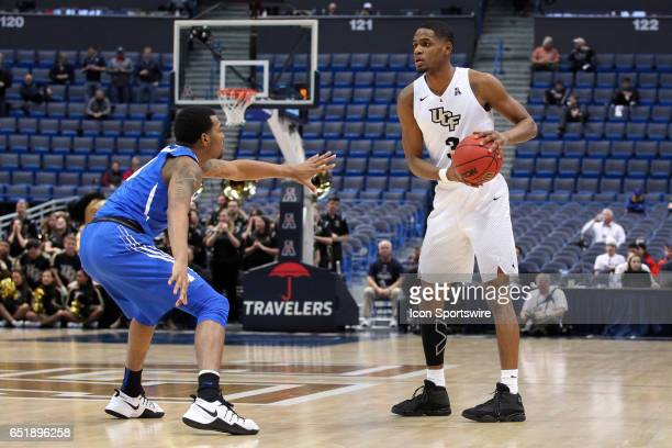 Knights guard AJ Davis and Memphis Tigers guard KJ Lawson in action during the first half of the American Athletic Conference quarterfinal game...