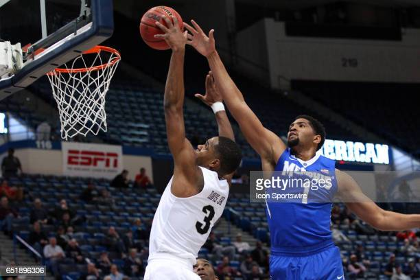 Knights guard AJ Davis drives past UCF Knights guard BJ Taylor during the first half of the American Athletic Conference quarterfinal game between...