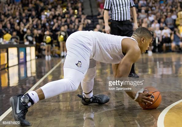 Knights guard BJ Taylor slips During the basketball game between the UCF Nights vs UCONN on February 11th 2017 at CFE Arena in Orlando Fl