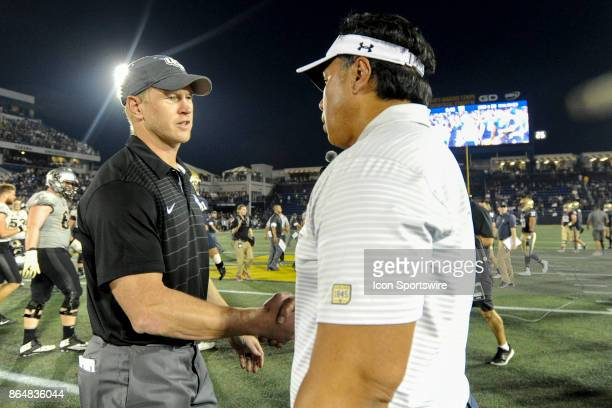 Knights head coach Scott Frost is congratulated by Navy Midshipmen head coach Ken Niumatalolo following their game on October 21 at Navy Marine Corps...