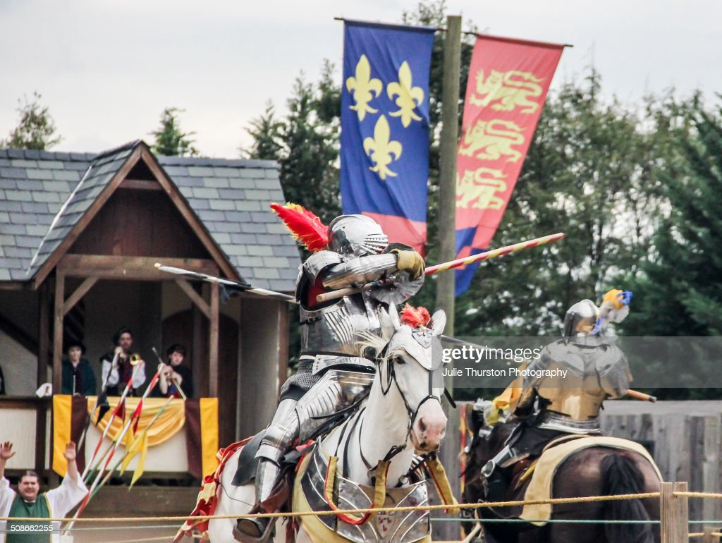 Knights in Costume Armour and Riding Horses Enter Strike Their Opponent With a Lance Weapon During a Reenactment Martial Jousting Battle at the Annual Maryland Renaissance Festival