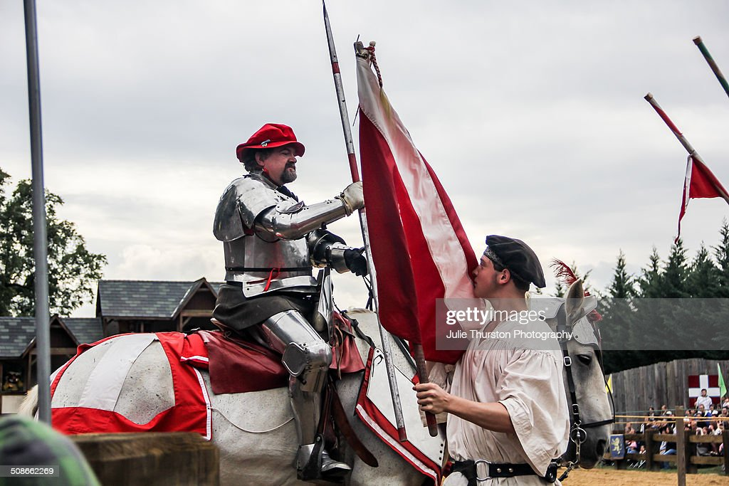 Knights in Costume Armour, With Flags and Riding Horses Enter the Ring to Strike Their Opponent With a Lance Weapon During a Reenactment Martial Jousting Battle at the Annual Maryland Renaissance Festival