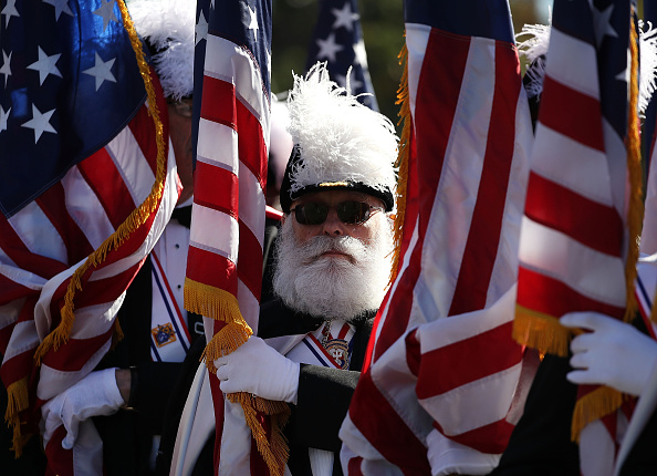 Knights of Columbus member Dick Bissel holds an Amerian flag during a Columbus Day ceremony at the National Columbus Memorial in front of Union...