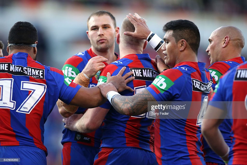 Knights players celebrate a try by Mitchell Barnett during the round 16 NRL match between the Newcastle Knights and the St George Illawarra Dragons at Hunter Stadium on June 25, 2016 in Newcastle, Australia.