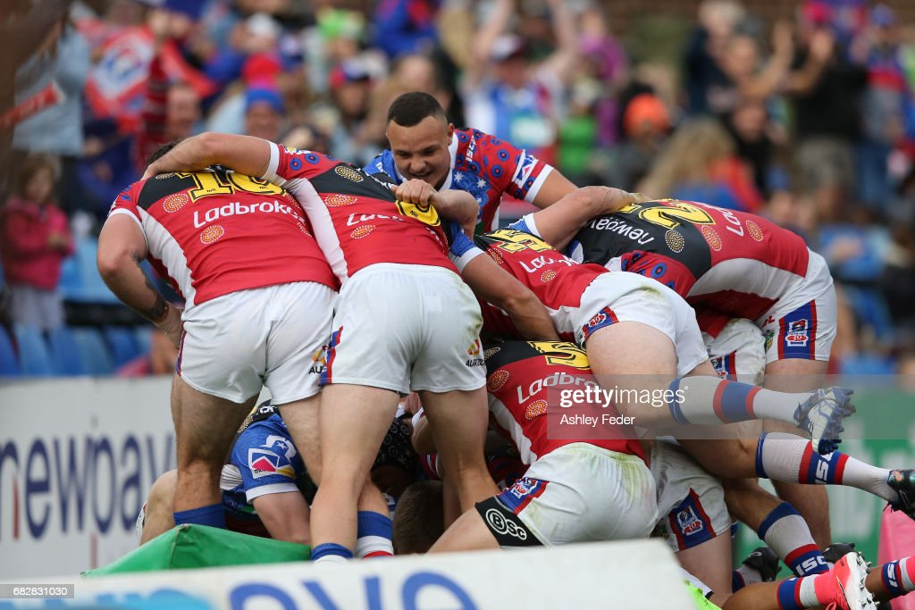 Knights players celebrate a try during the round 10 NRL match between the Newcastle Knights and the Canberra Raiders at McDonald Jones Stadium on May 14, 2017 in Newcastle, Australia.