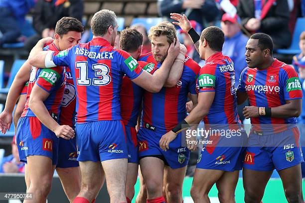 Knights players celebrate a try during the round 15 NRL match between the Newcastle Knights and the Cronulla Sharks at Hunter Stadium on June 21 2015...