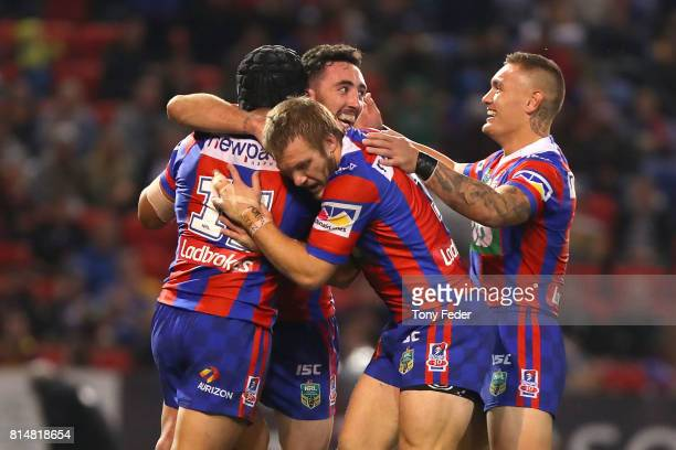 Knights players celebrate a try during the round 19 NRL match between the Newcastle Knights and the Brisbane Broncos at McDonald Jones Stadium on...