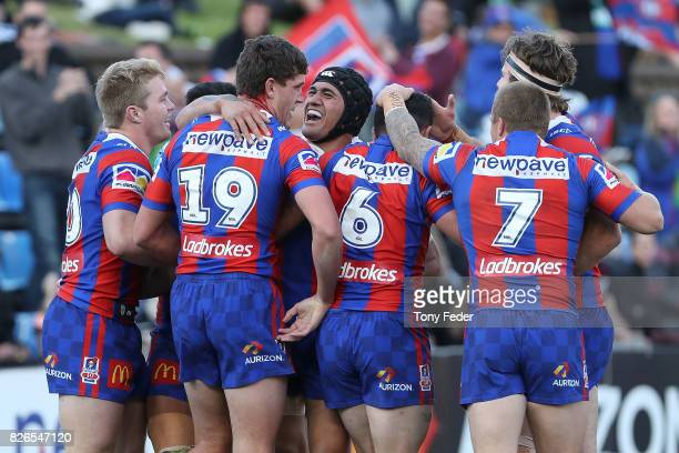 Knights players celebrate a try during the round 22 NRL match between the Newcastle Knights and the New Zealand Warriors at McDonald Jones Stadium on...