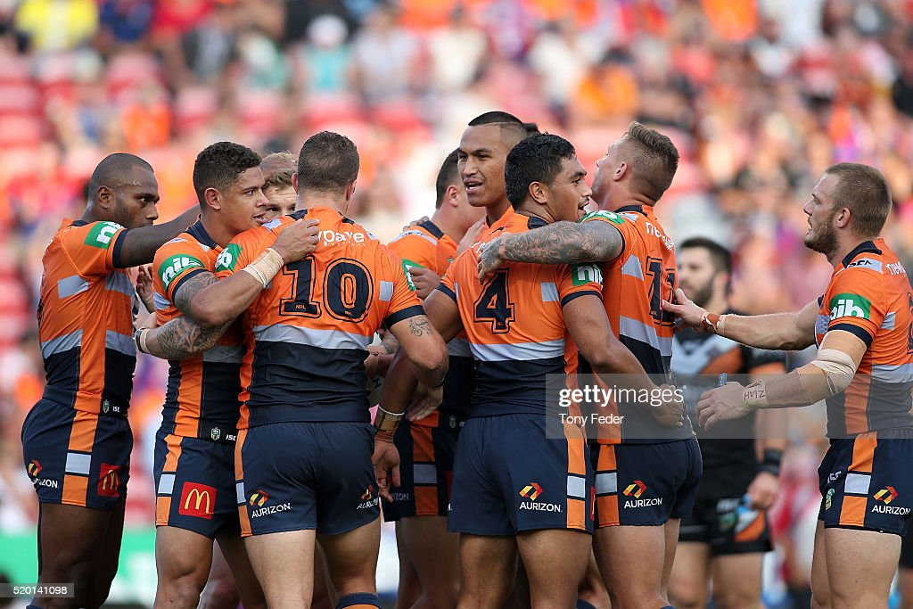 Knights players celebrate a try during the round six NRL match between the Newcastle Knights and the Wests Tigers at Hunter Stadium on April 10, 2016 in Newcastle, Australia.