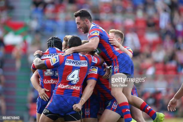 Knights players celebrate a try during the round three NRL match between the Newcastle Knights and the South Sydney Rabbitohs at McDonald Jones...