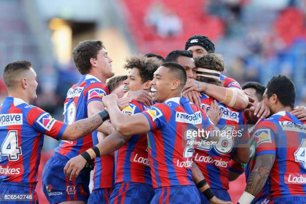 Knights players celebrate a try from Lachlan Fitzgibbon during the round 22 NRL match between the Newcastle Knights and the New Zealand Warriors at...