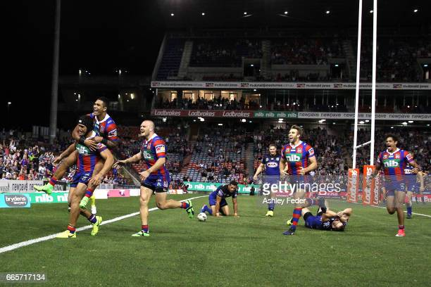 Knights players celebrate during the round six NRL match between the Newcastle Knights and the Canterbury Bulldogs at McDonald Jones Stadium on April...