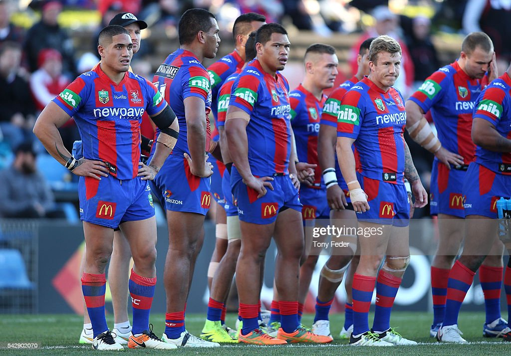 Knights players look dejected during the round 16 NRL match between the Newcastle Knights and the St George Illawarra Dragons at Hunter Stadium on June 25, 2016 in Newcastle, Australia.
