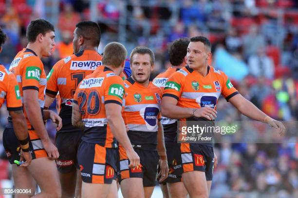 Knights players look on waiting for a decision during the round 17 NRL match between the Newcastle Knights and the Wests TIgers at McDonald Jones...
