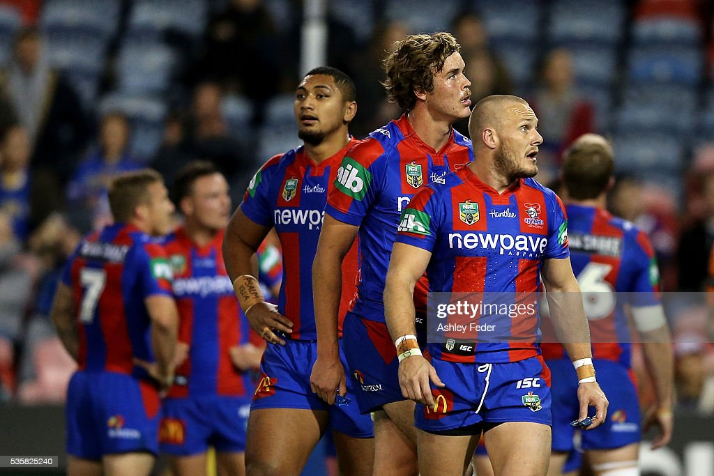 Knights players watch on during the round 12 NRL match between the Newcastle Knights and the Parramatta Eels at Hunter Stadium on May 30, 2016 in Newcastle, Australia.