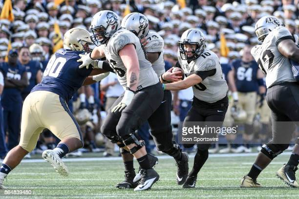 Knights quarterback McKenzie Milton runs for a first down in the first half against the Navy Midshipmen on October 21 at Navy Marine Corps Memorial...