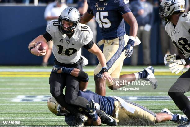 Knights quarterback McKenzie Milton scrambles in the first half against the Navy Midshipmen on October 21 at Navy Marine Corps Memorial Stadium in...