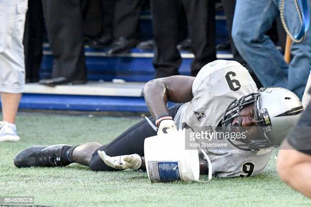 Knights running back Adrian Killins Jr rolls on the ground in pain after being shoved out of bounds on October 21 at Navy Marine Corps Memorial...