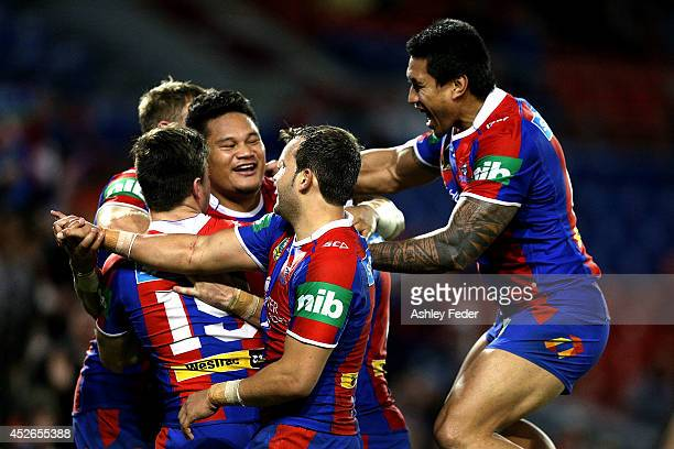 Knights teammaates celebrate a try by Joey Leilua during the round 20 NRL match between the Newcastle Knights and the Sydney Roosters at Hunter...