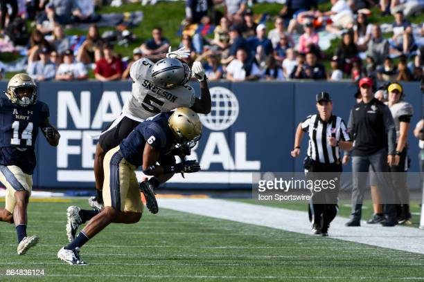 Knights wide receiver Dredrick Snelson cannot come up with a first half pass against the defense of Navy Midshipmen safety Sean Williams at Marine...