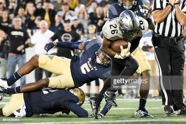 Knights wide receiver Otis Anderson scores on a fourth quarter run against Navy Midshipmen linebacker Justin Norton on October 21 at Navy Marine...