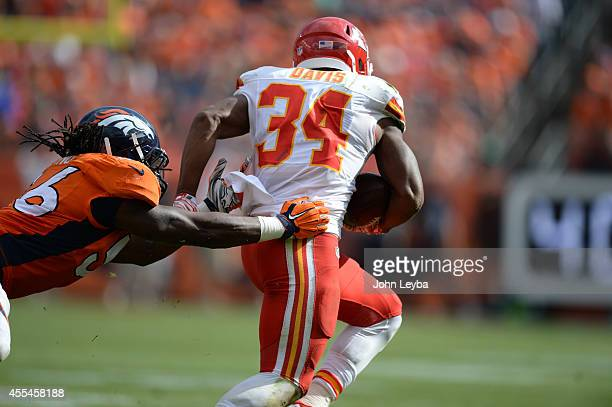 Knile Davis of the Kansas City Chiefs breaks a tackle attempt by Nate Irving of the Denver Broncos The Denver Broncos played the Kansas City Chiefs...