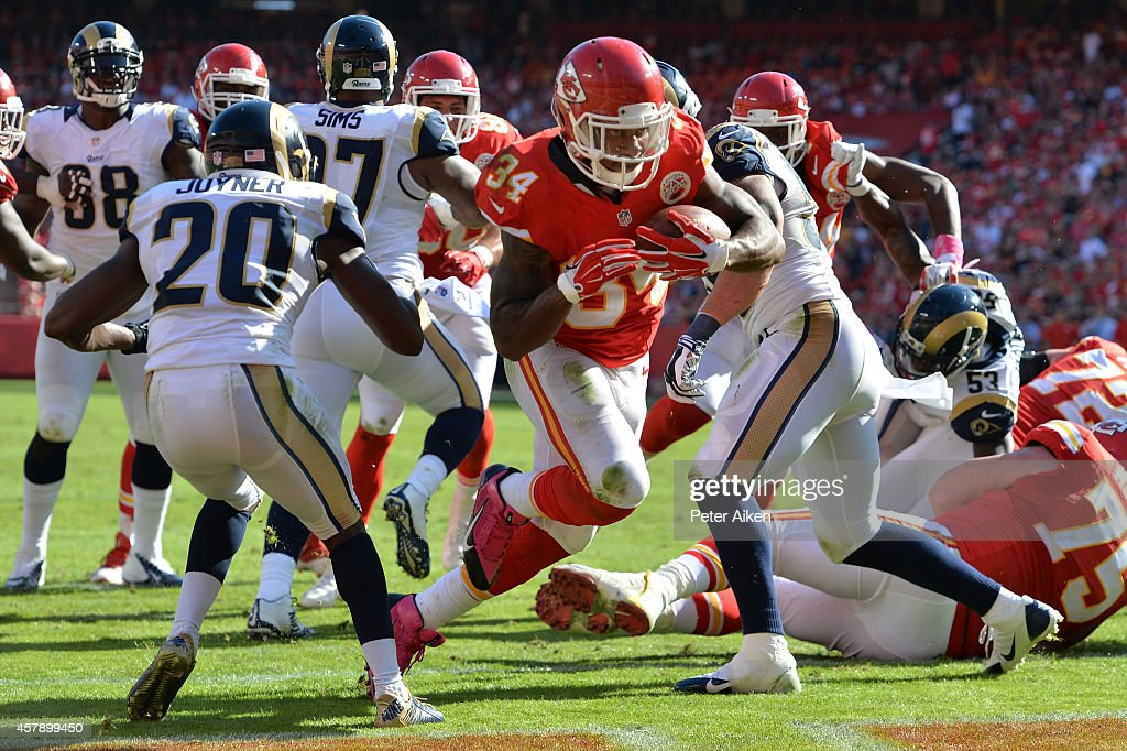 <a gi-track='captionPersonalityLinkClicked' href=/galleries/search?phrase=Knile+Davis&family=editorial&specificpeople=6475514 ng-click='$event.stopPropagation()'>Knile Davis</a> #34 of the Kansas City Chiefs scores a touchdown against the St. Louis Rams during the fourth quarter at Arrowhead Stadium on October 26, 2014 in Kansas City, Missouri.