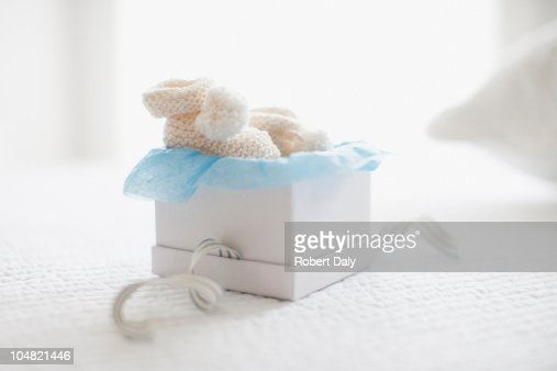 Knit baby booties in gift box : Stock Photo