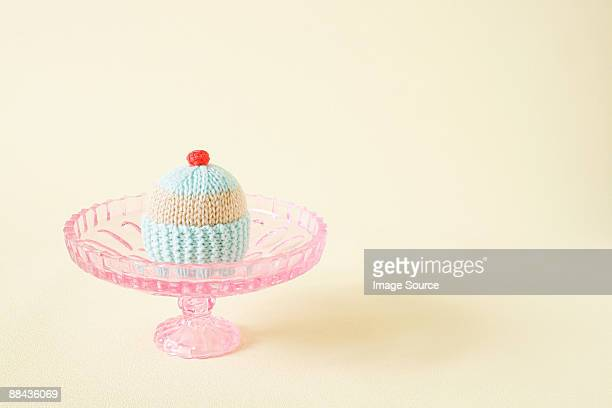 Knitted cupcake on a cakestand
