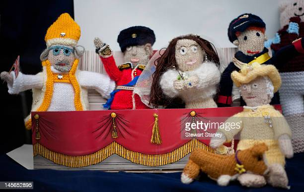Knitted figures of the royal family on display in a window at the Ightham medieval Coxcombe Fair to celebrate Queen Elizabeth II's Diamond Jubilee at...