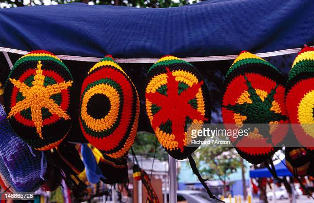 Knitted hats for sale at stall on Independence Square.