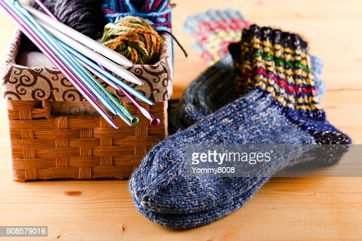Knitted socks next two box with other accessories : Stock Photo