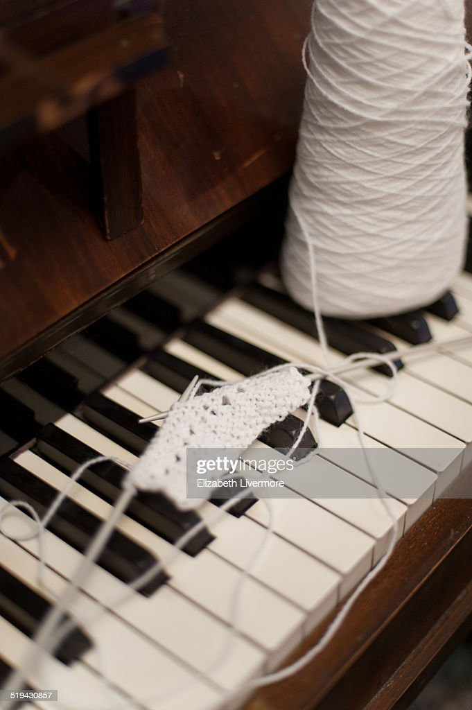 Knitting Pattern Piano Keyboard : Knitting On A Piano Stock Photo Getty Images