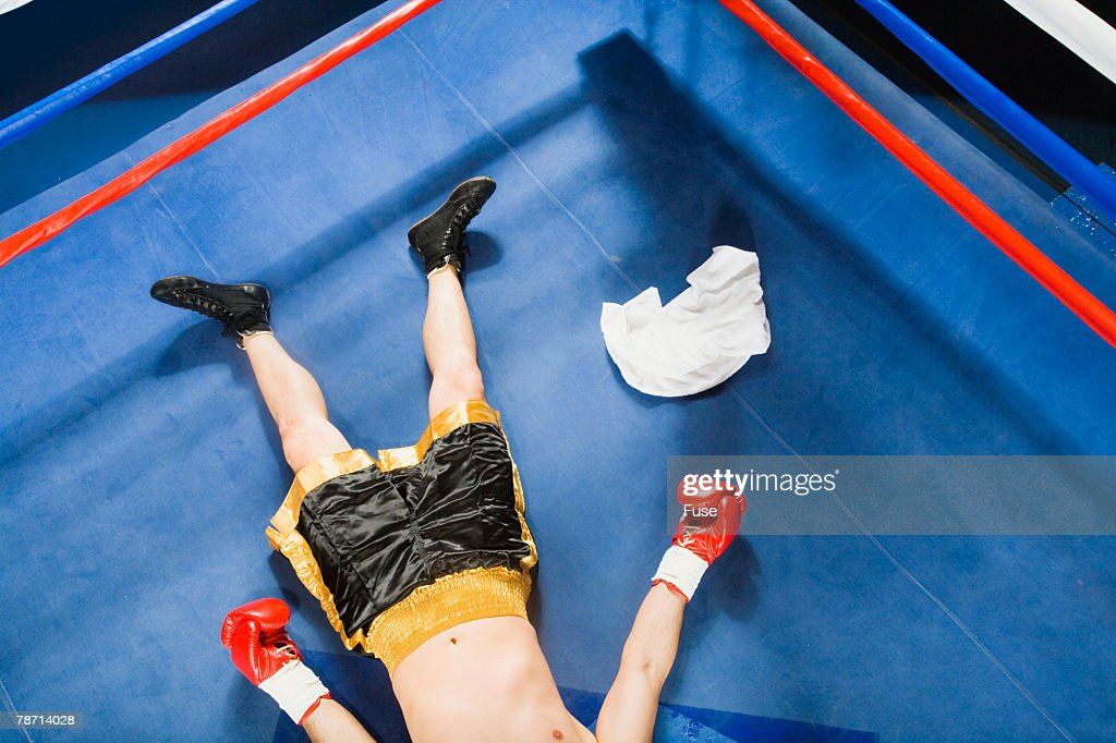 Knocked Out Boxer Lying on Ring