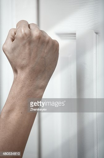 Knocking at the door : Stock Photo