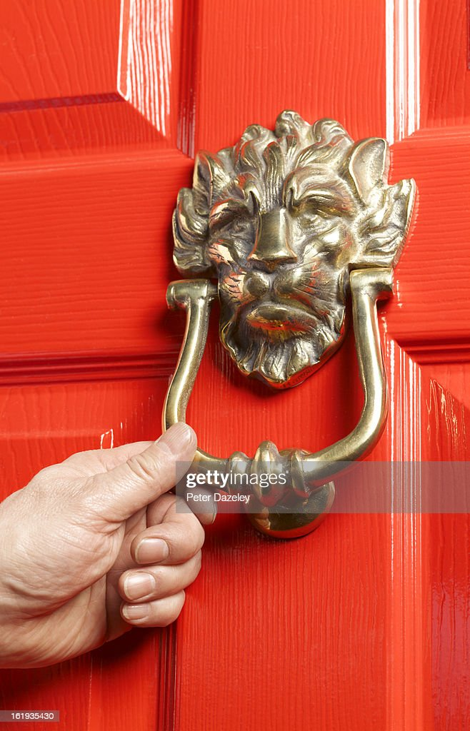 Knocking on red door : Stock Photo