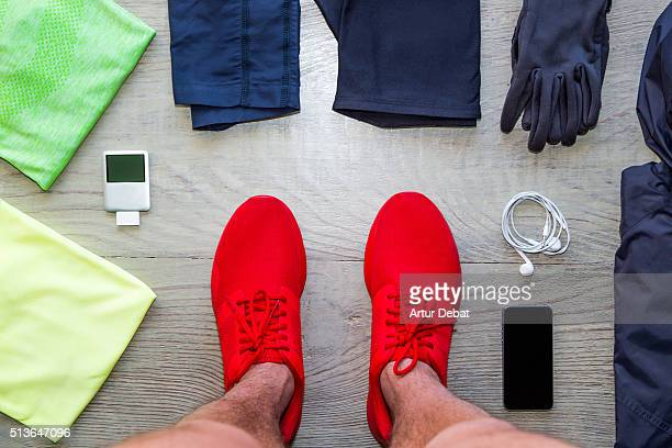 Knolling my running stuff and clothes on woody table from personal point of view, the art of organised objects in parallel with view from above.