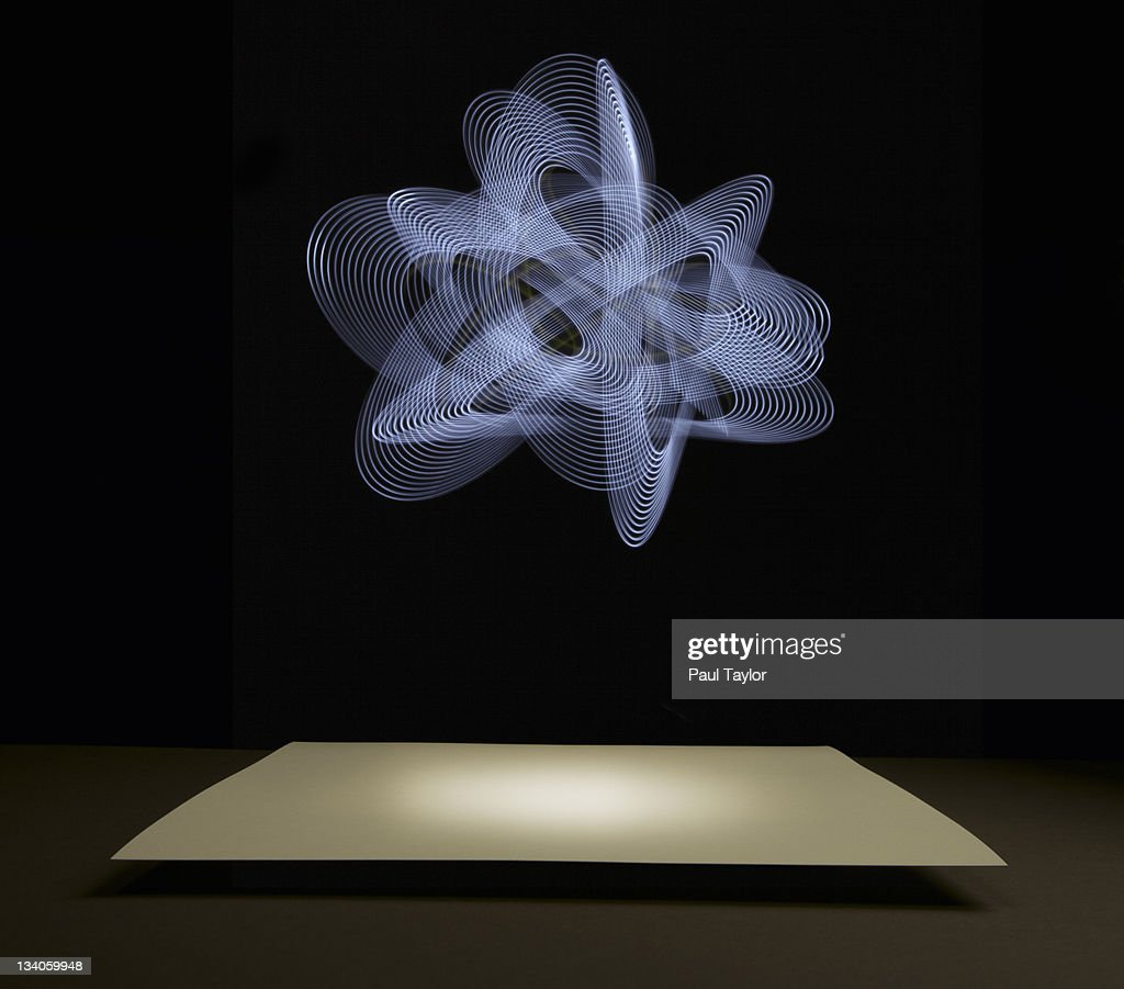 Knot of Light Over Paper : Stock Photo