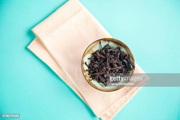 Knotted black tea leaves, artisanal variety
