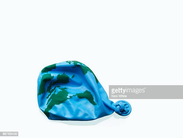 Knotted deflated balloon with world-map motif