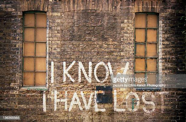 I know I have lost written on brick wall