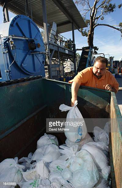 Knowaste Vice President Nazareth Chobanian lifts a bag of diapers awaiting recycling at the company's diaper recycling center November 15 2002 in Sun...