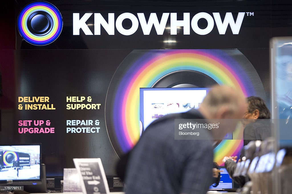 A 'Knowhow' logo sits above a checkout desk inside a Currys and PC World 2 in 1 store, operated by Dixons Retail Plc, at the Westfield Stratford City retail complex in London, U.K., on Thursday, Aug. 8, 2013. U.K. consumer confidence rose to the highest in more than three years as Britons' optimism about the economic outlook improved. Photographer: Simon Dawson/Bloomberg via Getty Images