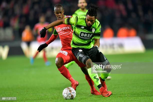 Knowledge Musona forward of KV Oostende battles for the ball with Christian Luyindama midfielder of Standard Liege during the Belgian Croky Cup match...