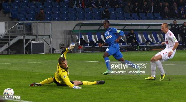 Knowledge Musona of Hoffenheim scores the second team goal against Michael Rensing keeper of Koeln and his team mate Miso Brecko during the DFB Pokal...