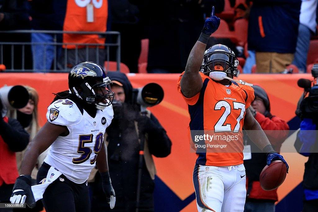Knowshon Moreno (R) #27 of the Denver Broncos celebrates after he scored a 14-yard touchdown reception in the second quarter against Dannell Ellerbe #59 of the Baltimore Ravens during the AFC Divisional Playoff Game at Sports Authority Field at Mile High on January 12, 2013 in Denver, Colorado.