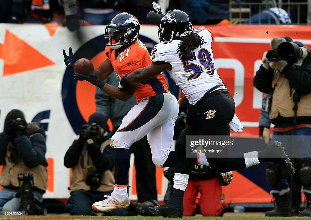 Knowshon Moreno #27 of the Denver Broncos catches a 14-yard touchdown reception in the second quarter against Dannell Ellerbe #59 of the Baltimore Ravens during the AFC Divisional Playoff Game at Sports Authority Field at Mile High on January 12, 2013 in Denver, Colorado.