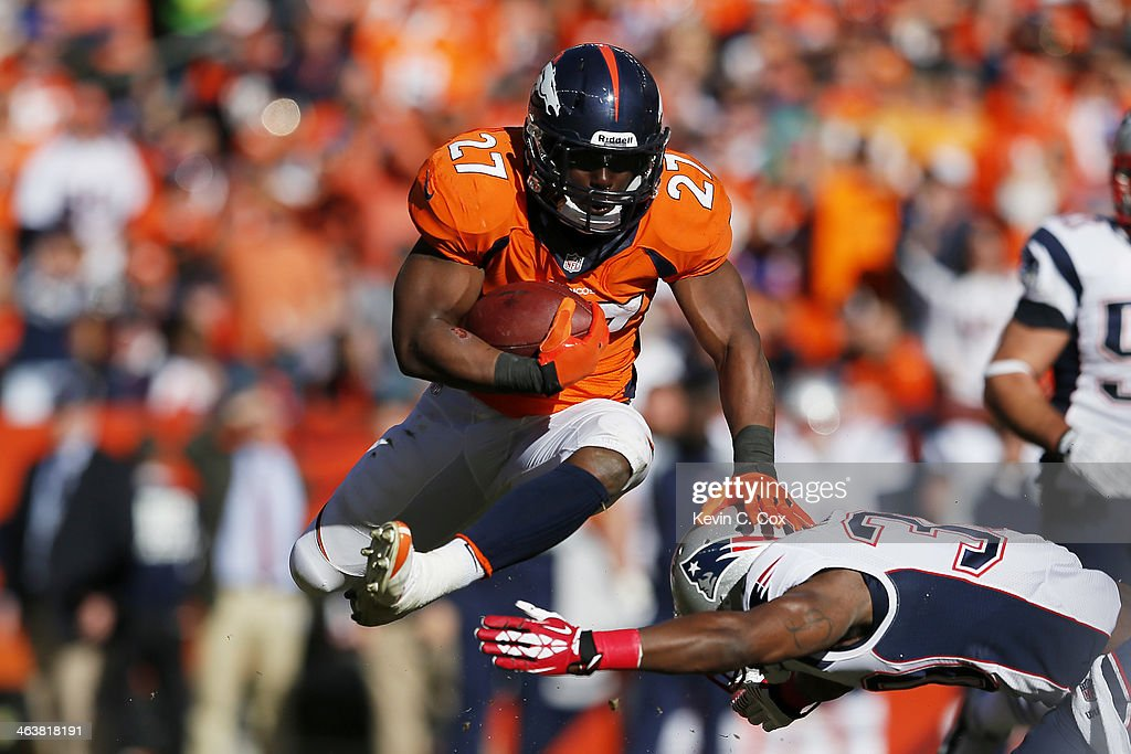 <a gi-track='captionPersonalityLinkClicked' href=/galleries/search?phrase=Knowshon+Moreno&family=editorial&specificpeople=3986554 ng-click='$event.stopPropagation()'>Knowshon Moreno</a> #27 of the Denver Broncos jumps over <a gi-track='captionPersonalityLinkClicked' href=/galleries/search?phrase=Duron+Harmon&family=editorial&specificpeople=8142142 ng-click='$event.stopPropagation()'>Duron Harmon</a> #30 of the New England Patriots in the second quarter during the AFC Championship game at Sports Authority Field at Mile High on January 19, 2014 in Denver, Colorado.